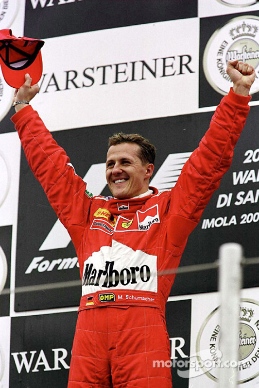 Podium: winner Michael Schumacher celebrates