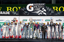 GX podium: class winners Nelson Canache, Shane Lewis, David Donohue, Jim Norman, second place James Clay, Darryl O'Young, Daniel Rogers, Seth Thomas, Karl Thomson, third place Lee Davis, Ryan Eversley, Eric Foss, Jeff Mosing, John Tecce