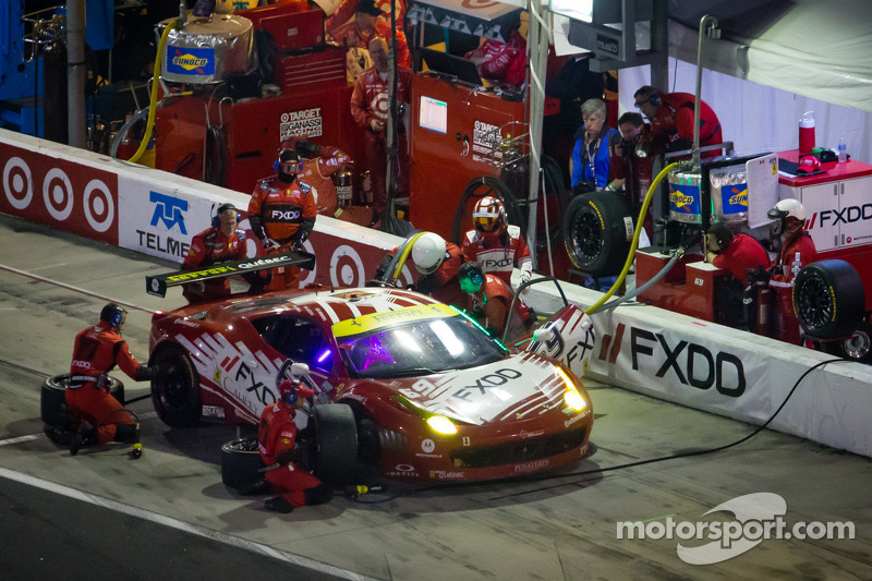 PIt stop for #69 AIM Autosport Team FXDD with Ferrari Ferrari 458: Emil Assentato, Anthony Lazzaro, Nick Longhi, Mark Wilkins