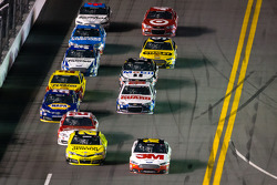 Matt Kenseth, Joe Gibbs Racing Toyota and Greg Biffle, Roush Fenway Racing Ford battle for the lead