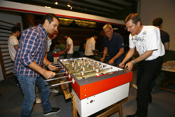 Benoit Tréluyer and Ralf Jüttner play foosball