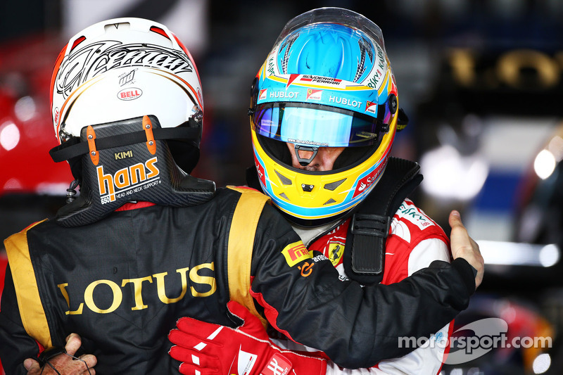 Race winner Kimi Raikkonen, Lotus F1 Team celebrates in parc ferme with Fernando Alonso, Ferrari