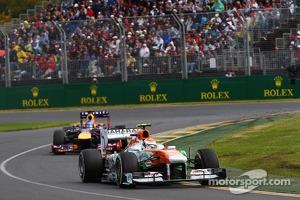 Adrian Sutil, Sahara Force India VJM06 leads Sebastian Vettel, Red Bull Racing RB9