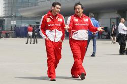 Andrea Stella, Ferrari Race Engineer with Hirohide Hamashima, Ferrari Tyre Engineer