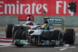 Lewis Hamilton, Mercedes AMG F1 W04 leads Jenson Button, McLaren MP4-28
