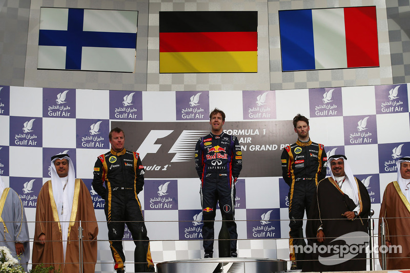 Podium: race winner Sebastian Vettel, Red Bull Racing, second place Kimi Raikkonen, Lotus F1 Team, t
