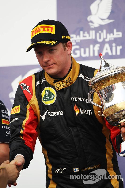 Kimi Raikkonen, Lotus F1 Team celebra a segunda posição no pódio