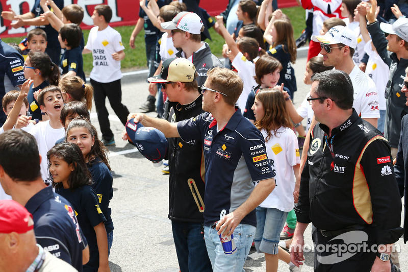 Sebastian Vettel, Red Bull Racing with Kimi Raikkonen, Lotus F1 Team at a FIA Safe Roads display with F1 personnel