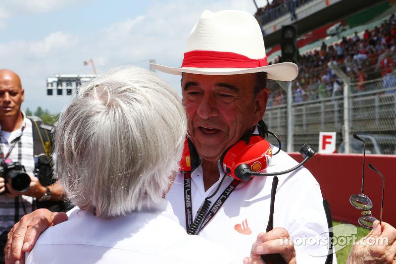(L to R): Bernie Ecclestone, CEO Formula One Group, with Emilio Botin, Santander Chairman on the gri