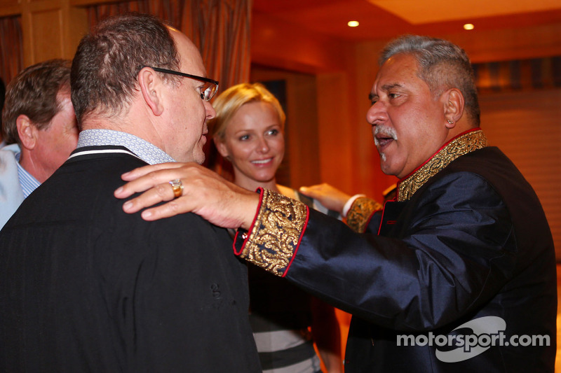 (L to R): HSH Prince Albert of Monaco, with his wife Princess Charlene of Monaco, and Dr. Vijay Mall