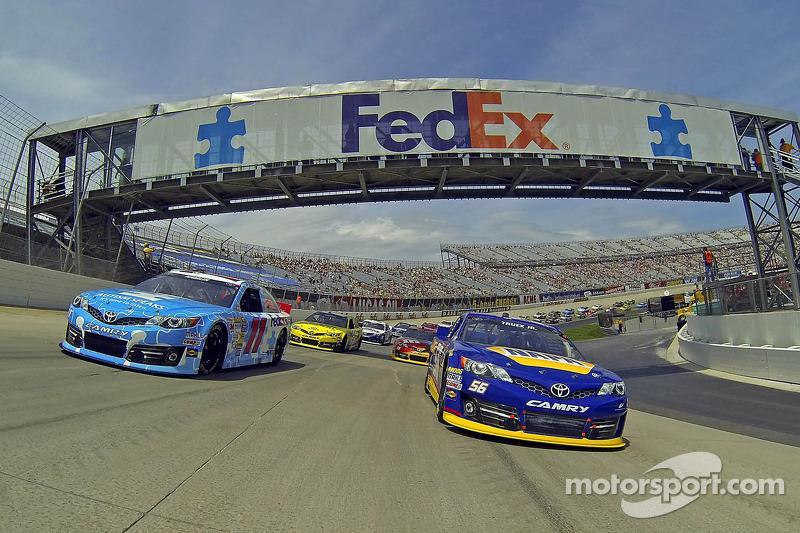 Denny Hamlin, Joe Gibbs Racing Toyota and Martin Truex Jr., Michael Waltrip Racing Toyota lead the field during pace laps