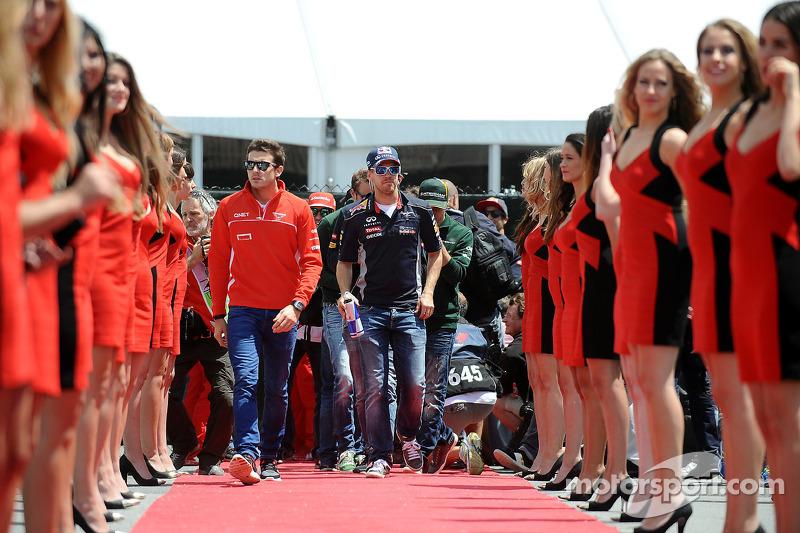 Jules Bianchi, Marussia F1 Team and Sebastian Vettel, Red Bull Racing
