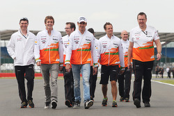 Adrian Sutil, Sahara Force India F1 and James Rossiter, Sahara Force India F1 Simulator Driver walk the circuit.