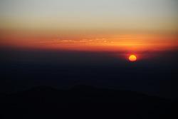 sun surge over Pikes Peak