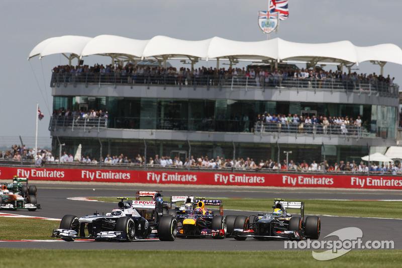 Valtteri Bottas Williams FW35 leads Mark Webber Red Bull Racing RB9 and Esteban Gutierrez Sauber C32