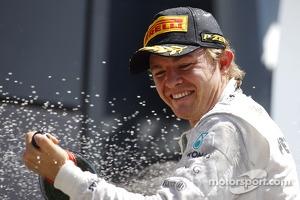 Race winner Nico Rosberg Mercedes AMG F1 celebrates on the podium