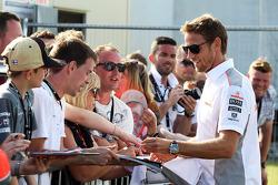 Jenson Button McLaren signs autographs for the fans at the post race concert