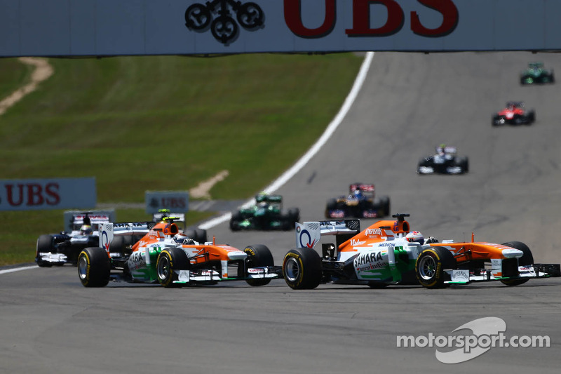 Paul di Resta, Sahara Force India VJM06 leads Adrian Sutil, Sahara Force India VJM06