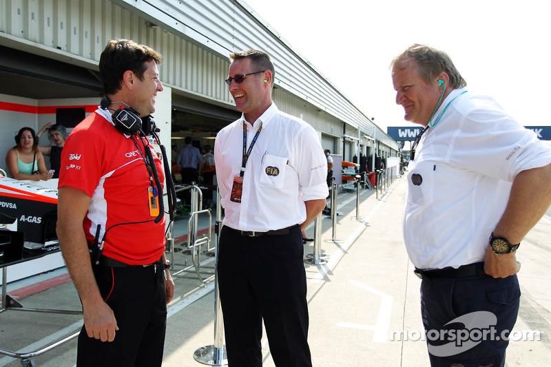 Dave O'Neill, Marussia F1 Team Manager met Jo Bauer, FIA Delegate