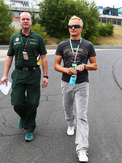 Heikki Kovalainen, Caterham F1 Team Reserve Driver walks the circuit