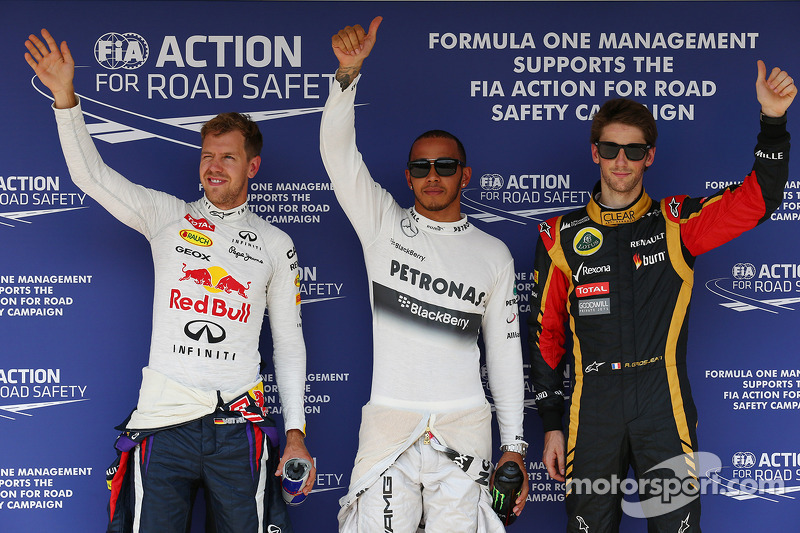 Pole for Lewis Hamilton, Mercedes AMG F1, 2nd Sebastian Vettel, Red Bull Racing and 3rd Romain Grosjean, Lotus F1 E21