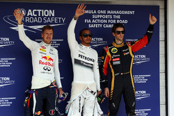 The top three qualifiers in Parc Ferme, Red Bull Racing, second; Lewis Hamilton, Mercedes AMG F1, pole position; Romain Grosjean, Lotus F1 Team, third