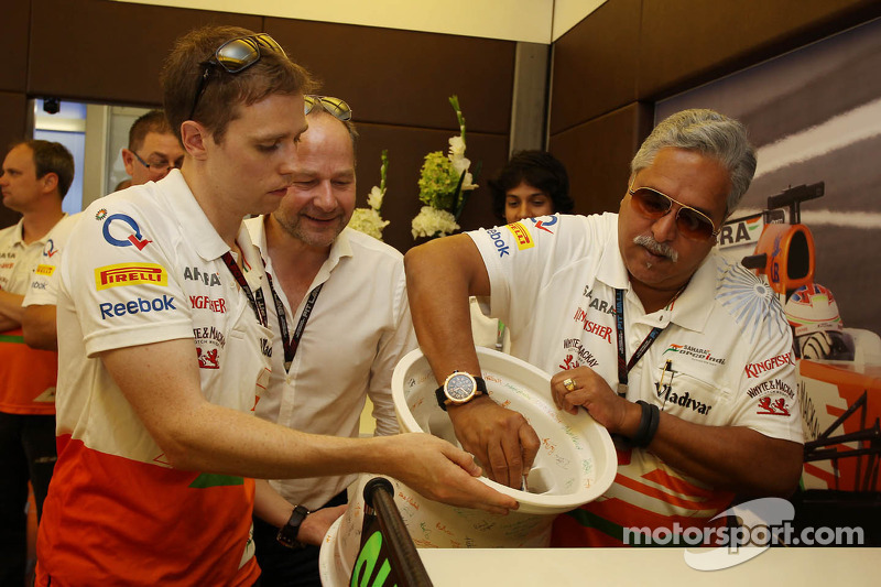 Dr. Vijay Mallya, Sahara Force India F1 Team Owner signs a ceramic wheel rim to be presented to Adri