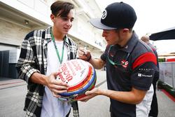 Santino Ferrucci, Haas F1 Team, signs an autograph