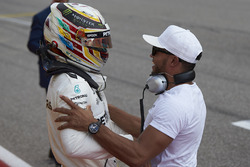 Lewis Hamilton, Mercedes AMG F1, celebrates with his brother Nicolas Hamilton, after securing pole position