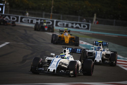 Felipe Massa, Williams FW38, leads Valtteri Bottas, Williams FW38, and Jolyon Palmer, Renault RE16