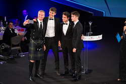 Presenter David Coulthard takes a selfie with George Russell, Lando Norris and Charles Leclerc