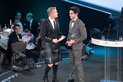 Enaam Ahmed on stage to accept the British Club Driver of the Year Award