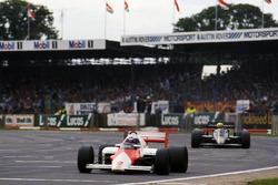 Alain Prost, McLaren MP4/2B leads Ayrton Senna, Lotus 95T