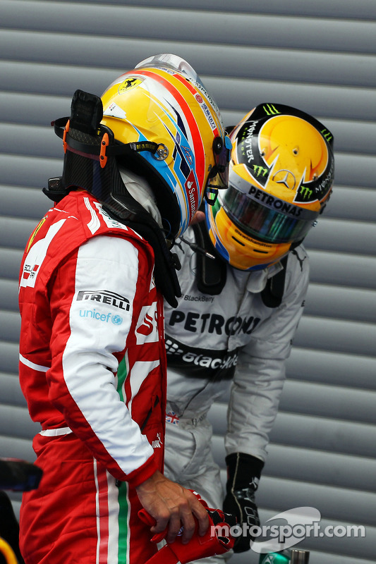 Fernando Alonso, Ferrari and Lewis Hamilton, Mercedes AMG F1 in parc ferme