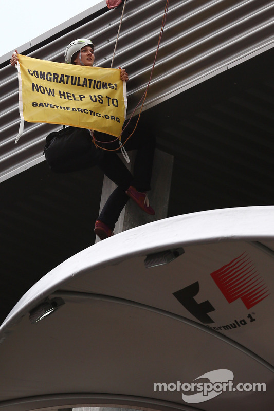 Greenpeace protester on the podium