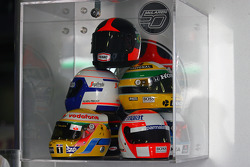 The helmets of past McLaren champs