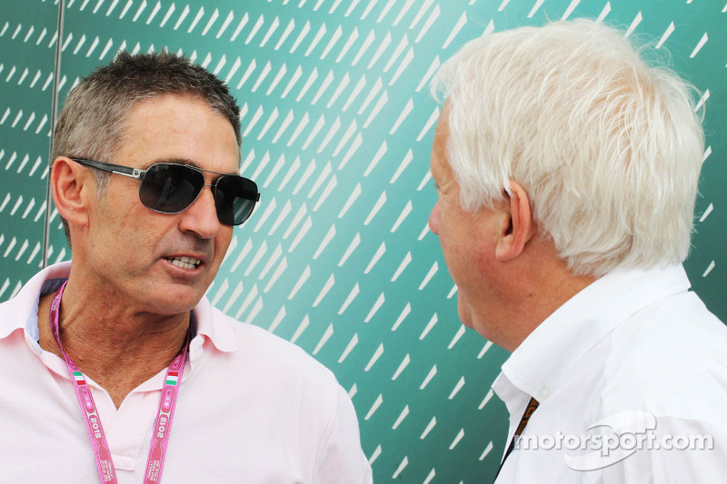 (L to R): Mick Doohan, Former 500c Motorbike World Champion with Charlie Whiting, FIA Delegate
