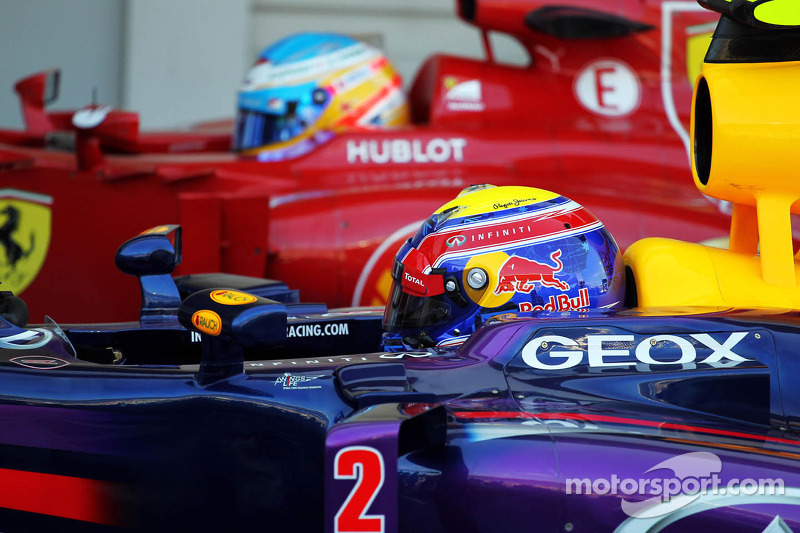 Pole sitter Mark Webber, Red Bull Racing RB9 and Fernando Alonso, Ferrari F138 in parc ferme
