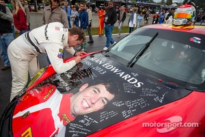 Cooper MacNeil signs the #30 NGT Motorsport Porsche 911 GT3 Cup with the Sean Edwards memorial livery