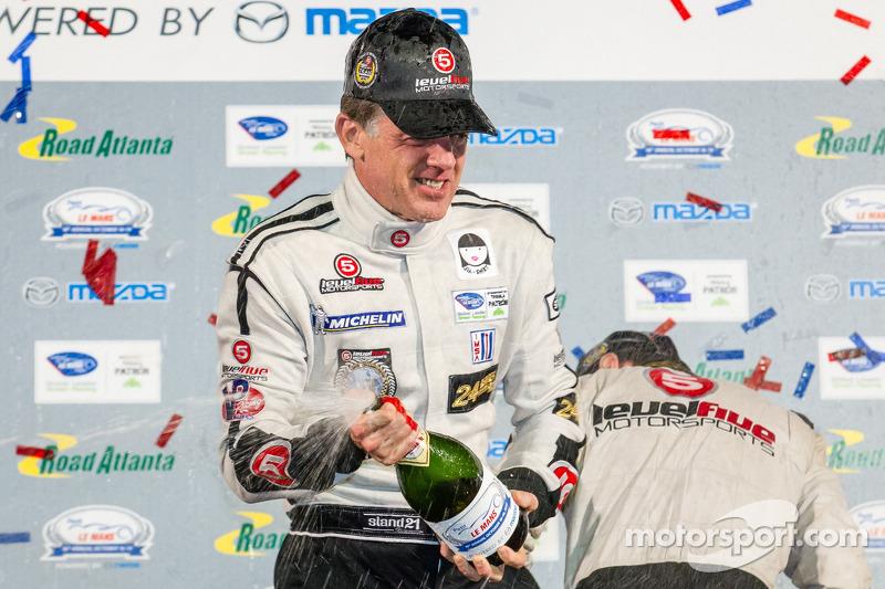 P2 podium: champagne for Scott Tucker