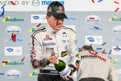 P2 podium: champagne for Scott Tucker