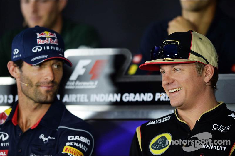 (L naar R): Mark Webber, Red Bull Racing en Kimi Raikkonen, Lotus F1 Team bij de FIA-persconferentie