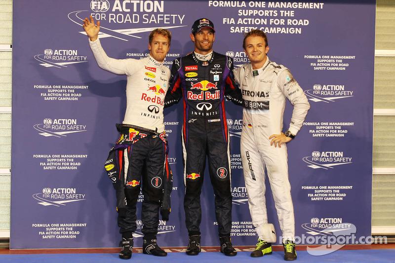 Qualifying top three in parc ferme, Sebastian Vettel, Red Bull Racing, second; Mark Webber, Red Bull