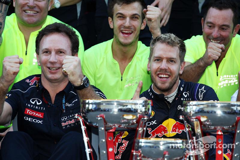 (L to R): Christian Horner, Red Bull Racing Team Principal and race winner Sebastian Vettel, Red Bul