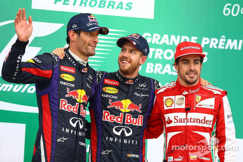 The podium: Mark Webber, Red Bull Racing, second; Sebastian Vettel, Red Bull Racing, race winner; Fernando Alonso, Ferrari, third