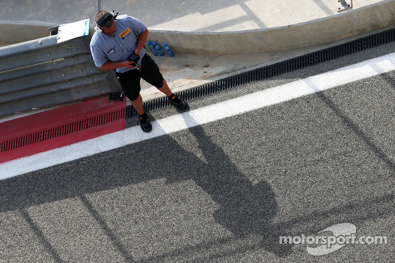 A Pirelli technician on the pit wall