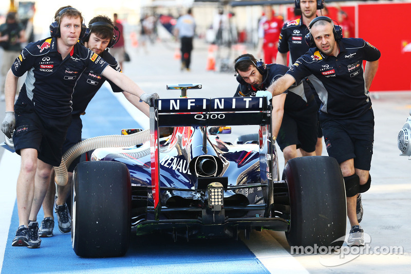 Sebastian Vettel, Red Bull Racing RB10 is pushed back down the pit lane by mechanics