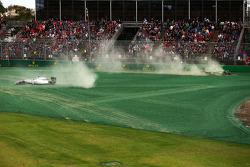 Felipe Massa, Williams FW36 and Kamui Kobayashi, Caterham CT05 crash out at the start of the race