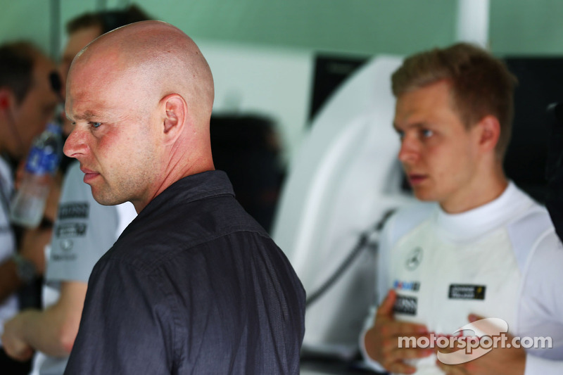(L to R): Jan Magnussen, with his son Kevin Magnussen, McLaren