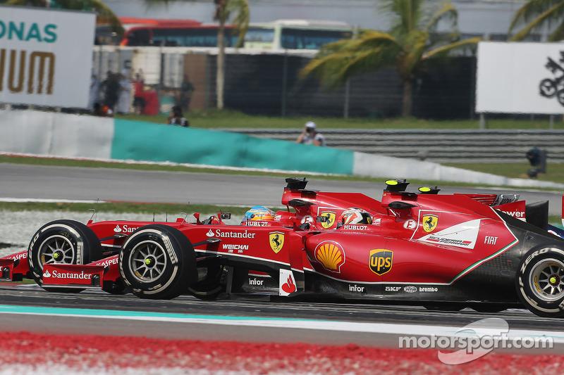 (L to R): Fernando Alonso, Ferrari F14-T and team mate Kimi Raikkonen, Ferrari F14-T at the start of the race
